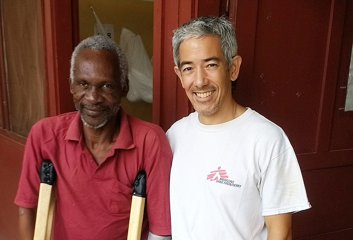 Dr. Edward Chu (right) and a patient in Bangui, Central African Republic.