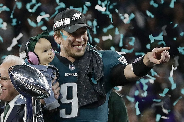 Philadelphia Eagles' Nick Foles holds his daughter, Lily, after beating the New England Patriots in Super Bowl 52 on Sunday, Feb. 4, 2018, in Minneapolis. (Frank Franklin II/AP)