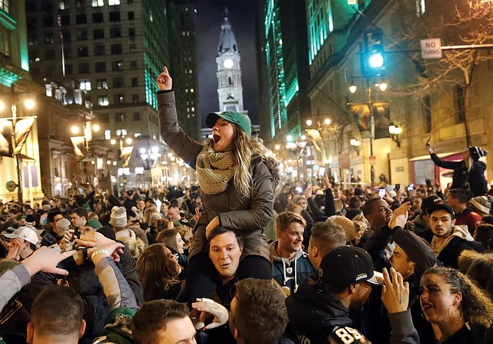 Philadelphia Eagles fans celebrate the team's victory in the Super Bowl 52 against the New England Patriots on Sunday, Feb. 4, 2018, in downtown Philadelphia. (Matt Rourke/AP)