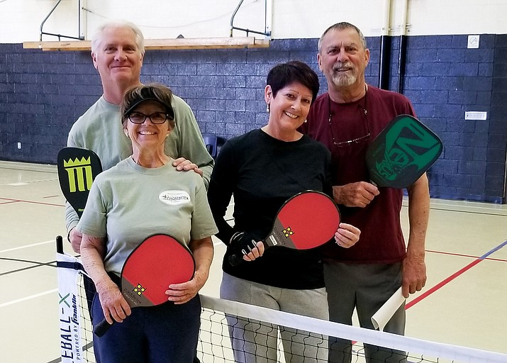 Gus and Libby Beatty and Becky Ebbert and Tom O'Dell enjoy a game of pickleball at the Williams Elementary-Middle School gym.