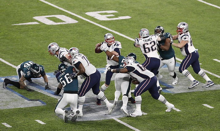 New England Patriots quarterback Tom Brady has the football knocked out of his hands for a fumble by Philadelphia Eagles defensive end Brandon Graham in the fourth quarter of the NFL Super Bowl 52 football game, Sunday, Feb. 4, in Minneapolis. Public awareness of the health risks that football players face has not dampened enthusiasm for the sport. (Tyler Kaufman/AP)