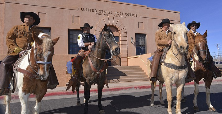 Riders recreate the Hashknife Pony Express ride at Winslow Post Office Feb. 2.