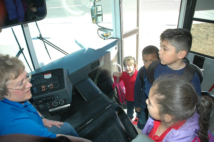 Kristen Lawrence welcomes students on the bus home from school on Wednesday, Feb. 7. (L-R): Makenzie Canova, Ryan Garcia, Nicholas Padilla and Adisynne Franchello. (Jason Wheeler/Courier)