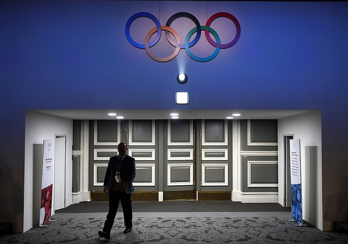 A member of the International Olympic Committee walks into the 132nd IOC Session prior to the 2018 Winter Olympics in Pyeongchang, South Korea, Wednesday, Feb. 7, 2018. (AP Photo/Patrick Semansky)