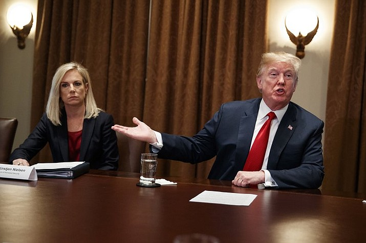 Secretary of Homeland Security Kirstjen Nielsen listens as President Donald Trump speaks during a meeting with law enforcement officials on the MS-13 street gang and border security, in the Cabinet Room of the White House, Tuesday, Feb. 6, 2018, in Washington. Trump has asked the Pentagon to plan a grand parade of the U.S. armed forces in Washington this year to celebrate military strength. (AP Photo/Evan Vucci)