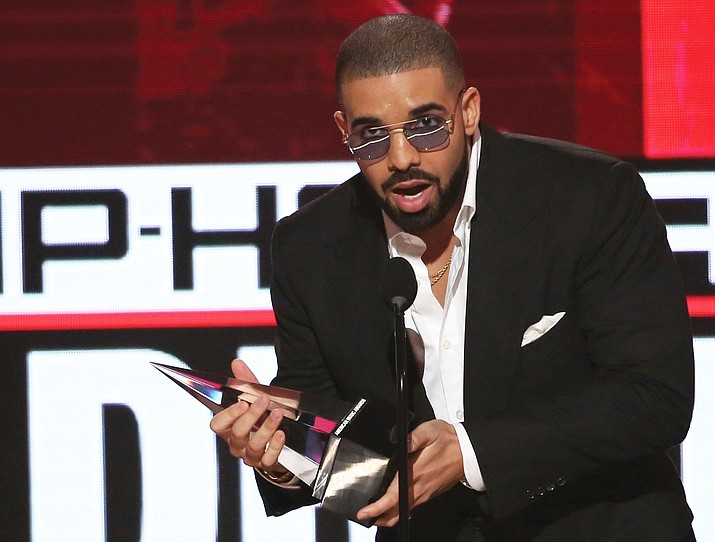 In this Nov. 20, 2016, file photo, Drake accepts the award for favorite artist - rap/hip-hop - at the American Music Awards at the Microsoft Theater in Los Angeles.  