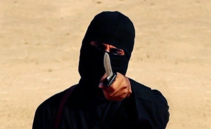 "This image taken from a video released by the Islamic State shows a masked militant holding a knife as he speaks to the camera in a desert region before a brutal beheading. Two fighters who were part of the notorious kidnapping cell dubbed ""The Beatles"" for their British accents have been captured in Syria, a US defense official confirmed Thursday."