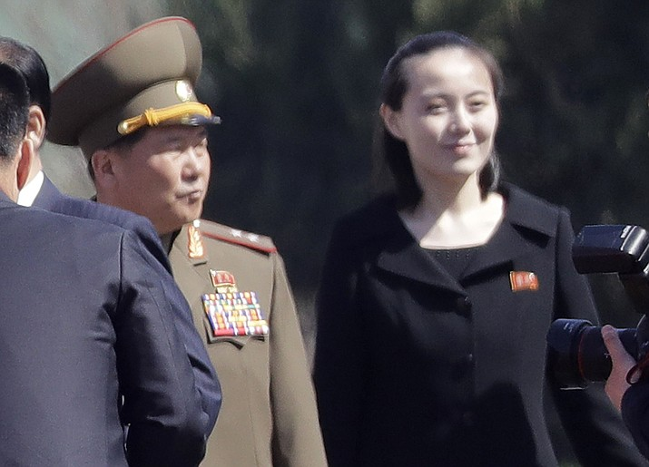 In this April 13, 2017, photo, Kim Yo Jong, right, sister of North Korean leader Kim Jong Un, is pictured during the official opening of the Ryomyong residential area, a collection of more than a dozen apartment buildings, in Pyongyang, North Korea. South Korea's Unification Ministry said North Korea informed Wednesday, Feb. 7, 2018, that Kim Yo Jong would be part of the high-level delegation coming to the South for the Pyeongchang Winter Olympics. (AP Photo/Wong Maye-E)
