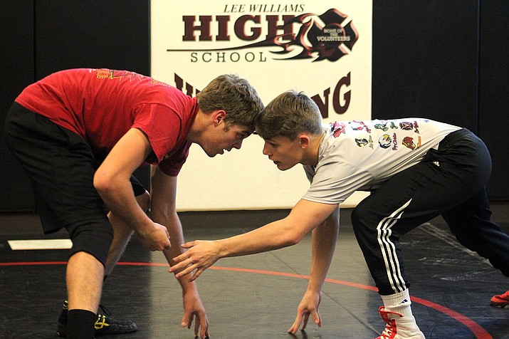 Lee Williams' Johnathan Montoya, left, and Jimmy Wayman square off this week at practice. The duo open state competition today at the Prescott Valley Event Center.