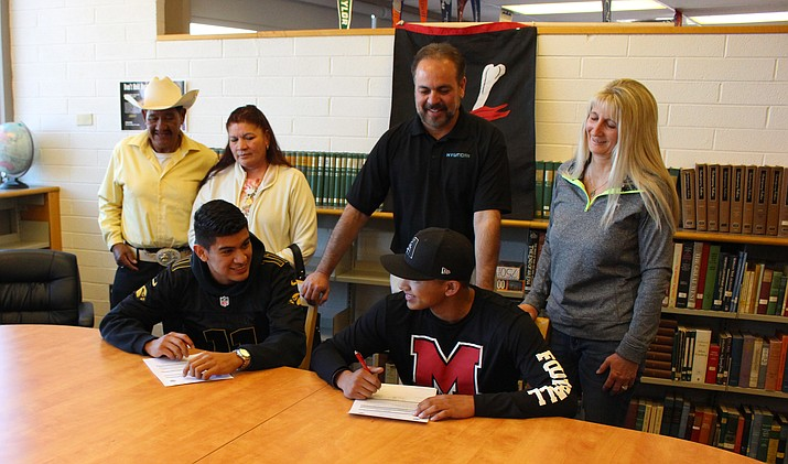 Mingus seniors Martin Soria (left) and Marcos Valenzuela (right) sign with Phoenix College football on Wednesday at the MUHS library. (VVN/James Kelley)