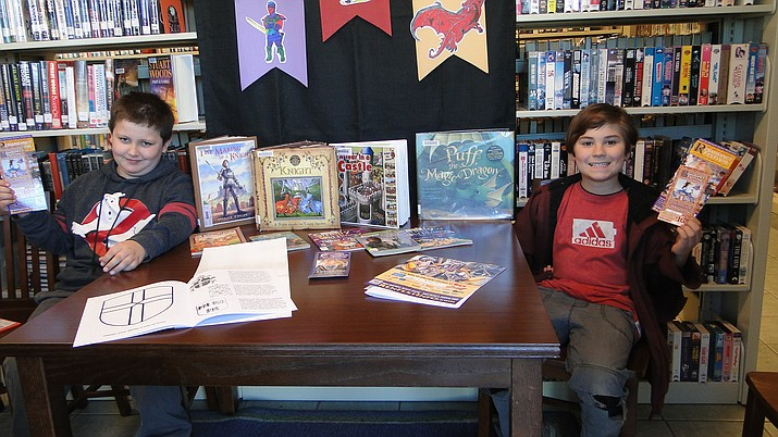 Rylan Hodges and Isaiah Karn have completed their 12 books under the guidance and supervision of Kairi Kline, library coordinator. (Courtesy)