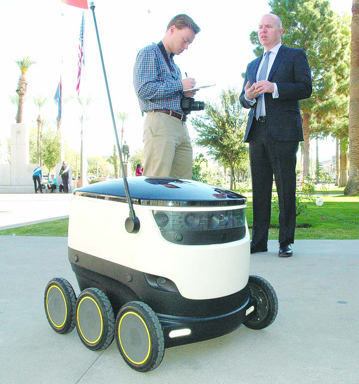 David Catania, spokesman for Starship Technologies on right, explains how the diminutive autonomous robot could be used to deliver everything from groceries and prescriptions to mail – if Arizona lawmakers legalize the operation of the devices on sidewalks.