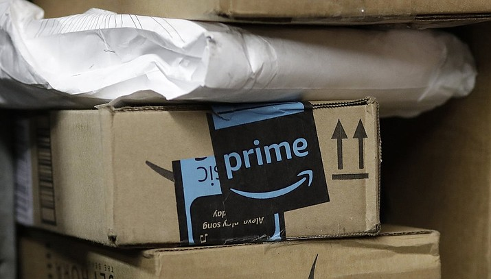A Massachusetts couple says it was fun when they started receiving unsolicited Amazon packages. Now they want it to stop. (Mark Lennihan / The Associated Press, file)