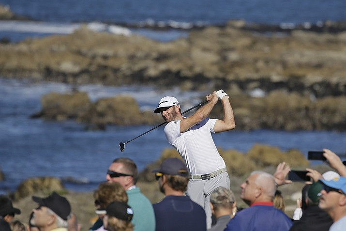 Dustin Johnson follows his shot from the 13th tee of the Monterey Peninsula Country Club Shore Course during the second round of the AT&T Pebble Beach National Pro-Am golf tournament Friday, Feb. 9, 2018, in Pebble Beach, Calif. (Eric Risberg/AP)