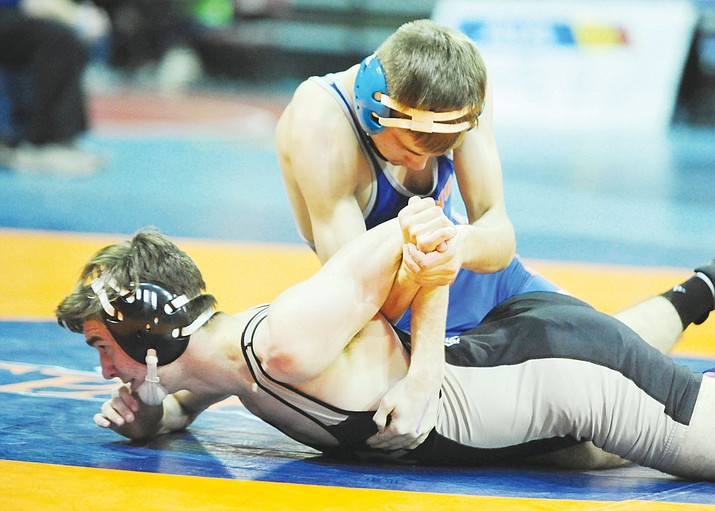 Chino Valley's J.C. Mortensen won his match Friday during the first round of the Arizona Interscholastic Association wrestling tournament at the Prescott Valley Event Center. He finished fifth overall in the state tournament. (Les Stukenberg/Courier)