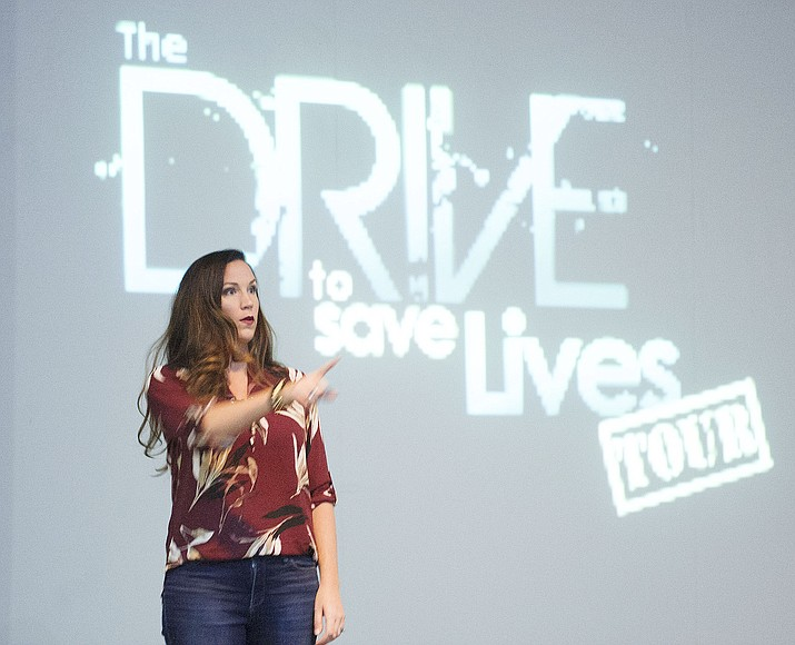 Cara Filler, a youth motivational speaker, talks to students at Prescott High School Friday morning about making good choices as they go through life. (Les Stukenberg/Courier)