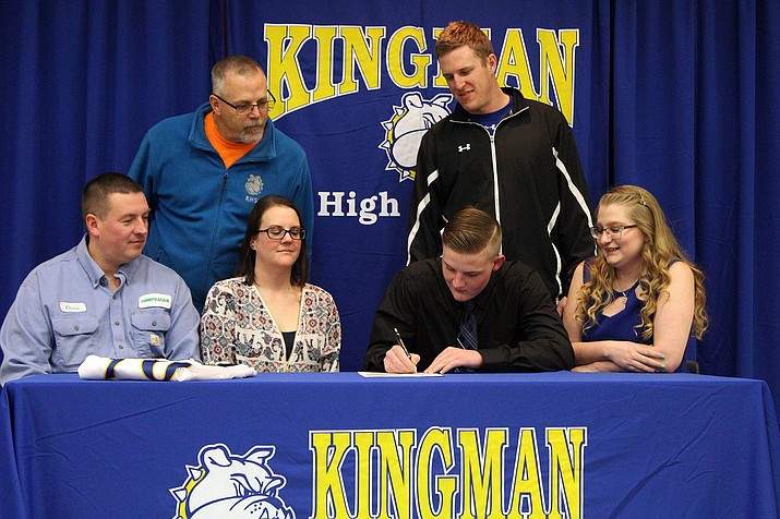 Kingman High's Chris Gomez signs to play football at Missouri Valley College.
