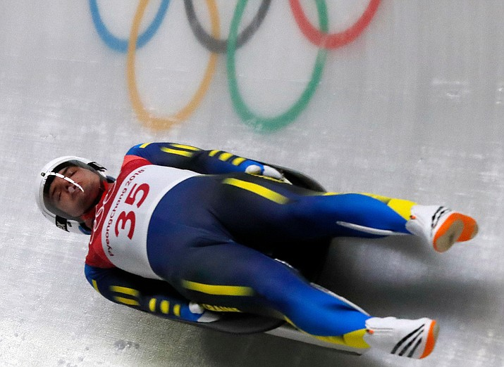 Anton Dukach of Ukraine competes in the second round of the men's luge at the 2018 Winter Olympics in Pyeongchang, South Korea, Saturday, Feb. 10, 2018. (AP Photo/Andy Wong)