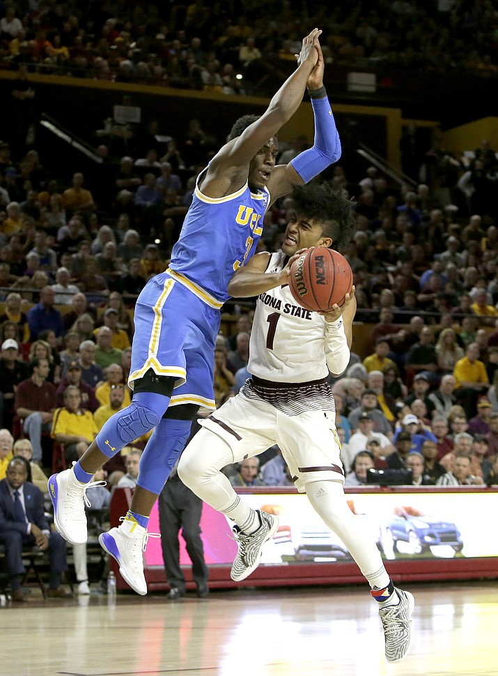 UCLA guard Aaron Holiday fouls Arizona State guard Remy Martin (1) in the second half during an NCAA college basketball game, Saturday, Feb. 10, 2018, in Tempe. Arizona State defeated UCLA 88-79. (Rick Scuteri/AP)