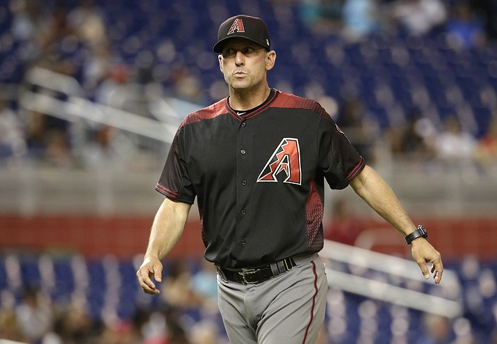 In this June 1, 2017, file photo, Arizona Diamondbacks manager Torey Lovullo walks from the mound during a baseball game against the Miami Marlins in Miami. Lovullo was named National League manager of the year for his work in his first season in Arizona. (Lynne Sladky/AP, File)