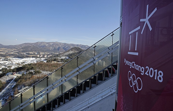 The countryside below is seen from the top of the 125-K large hill between practice sessions for the men's ski jumping competition at the Aplensia Ski Jumping Center in the 2018 Winter Olympics in Pyeongchang, South Korea, Wednesday, Feb. 7, 2018. (AP Photo/Charlie Riedel)