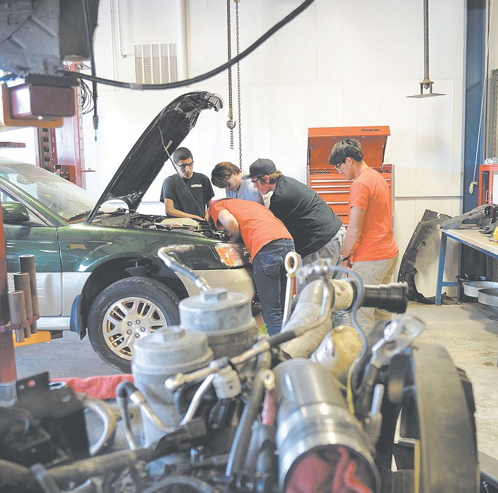 Lee Williams High School students work on a car in their automotive class. A bill before the Arizona Legislature would restore partial funding for freshmen taking Career and Technical Education courses through the Joint Technical Education District, or JTED.