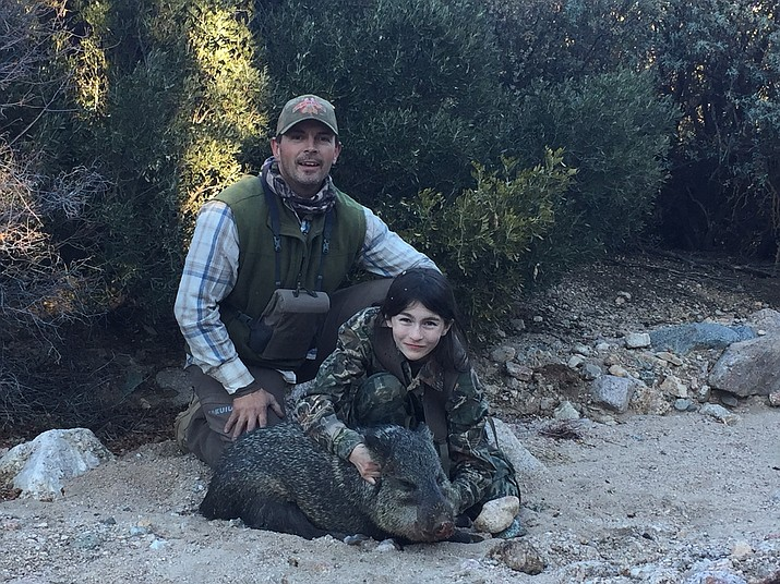 Kenny Upton and his 12-year-old daughter Natalie show the javelina she shot on the opening weekend of her youth hunt in Unit 16A. Natalie took the boar with one shot at 89 yards. (Photo special to the Miner)
