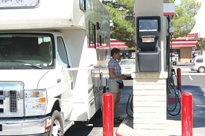 A traveler fuels up at a Kingman gas station in this 2014 file photo. An American Automobile Association report stated the Lake Havasu City-Kingman area has the highest gas prices in Arizona.