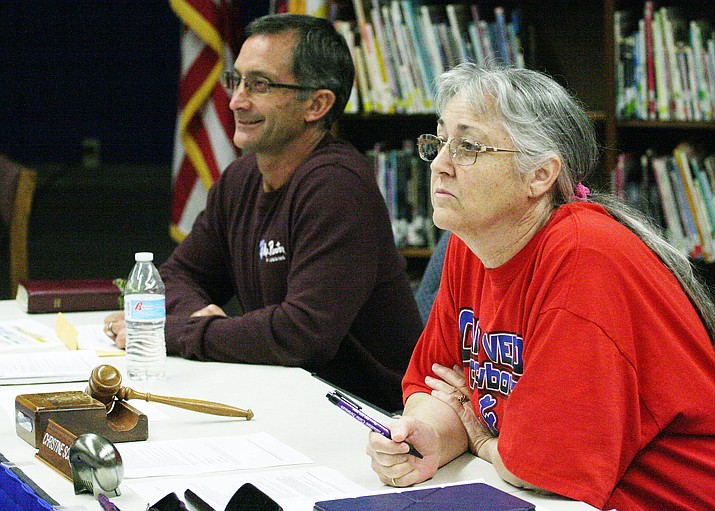 Christine Schneider has resigned her position with Camp Verde Unified School District's governing board, effective Feb. 14. Schneider, pictured at right with board president Tim Roth, has been on the board for the past five years. (Photo by Bill Helm)