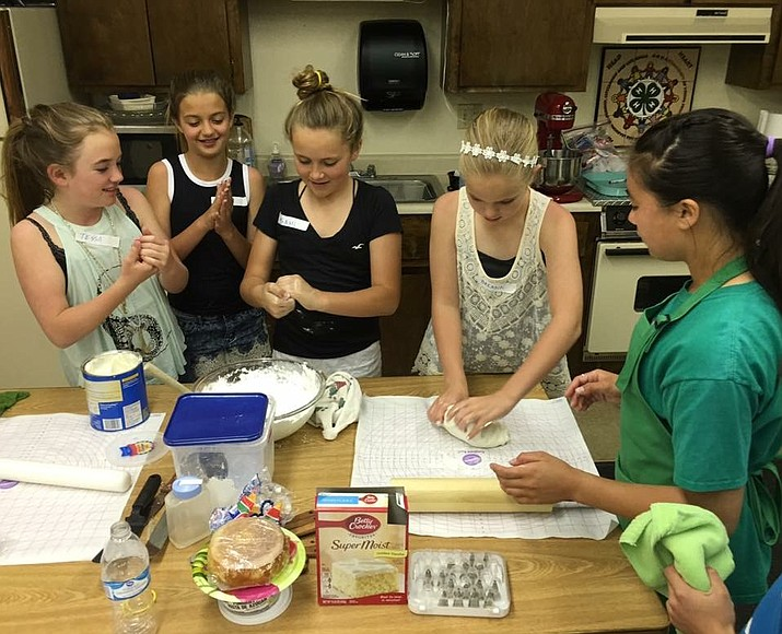 Amelia Brackett, right, teaches girls how to mix their own fondant in a Mohave County 4-H cake decorating class. The next class is scheduled for Feb. 23. (Courtesy photo)