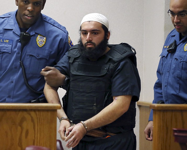In this Dec. 20, 2016, file photo, Ahmad Khan Rahimi, center, is led into court in Elizabeth, N.J. Rahimi, who set off small bombs on a New York City street and at a charity race in New Jersey, is set to be sentenced to a mandatory term of life in prison. He is scheduled to be sentenced Tuesday, Feb. 13, 2018, by a federal judge in Manhattan. (AP Photo/Mel Evans, File)