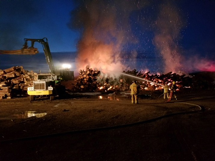A fire broke out in a stack of logs at the NewPac mill on Garland Prairie Road Feb. 5. No one was injured in the incident, but arson is suspected in the early morning blaze. (Submitted photo)