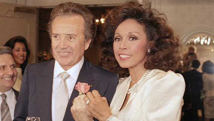 FILE - In this Jan. 3, 1987 file photo, Vic Damone, left, and Diahann Carroll show off their rings after wedding in Atlantic City, N,J. Damone died Sunday, Feb. 11, 2018, at a Miami Beach hospital from complications of a respiratory illness. He was 89. (AP Photo/Scott Stetzer, File)