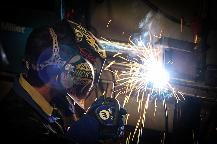 A welding student at Ash Fork High School competes at the SkillsUSA competition in Holbrook Feb. 3. (Photo courtesy of Cris Acosta)