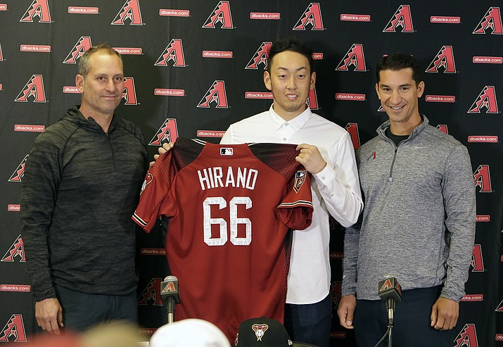 Arizona Diamondbacks manager Torey Lovullo, left, and general manager Mike Hazen, right, flank pitcher Yoshihisa Hirano, of Japan, during an introductory press conference Monday, Feb. 12, 2018, in Scottsdale. (Rick Scuteri/AP)