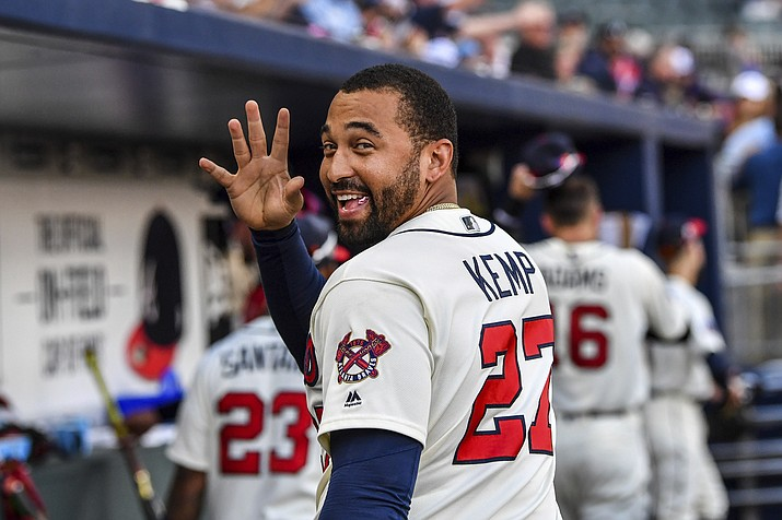 Atlanta Braves' Matt Kemp waves to a fan after the team's game against the Milwaukee Brewers on Saturday, June 24, 2017, in Atlanta. (Danny Karnik/AP, File)