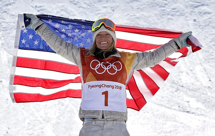 Jamie Anderson, of the United States, celebrates winning gold after the women's slopestyle final at Phoenix Snow Park at the 2018 Winter Olympics on Monday, Feb. 12, 2018. in Pyeongchang, South Korea. (Lee Jin-man/AP)
