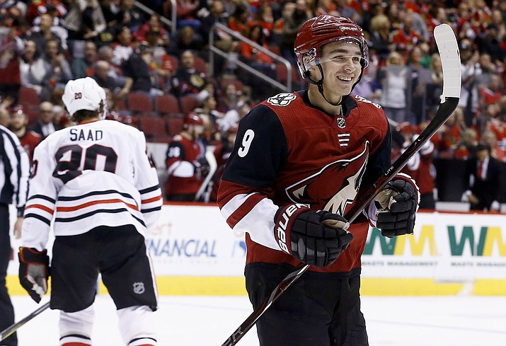 Arizona Coyotes center Clayton Keller (9) smiles as he celebrates a goal by Coyotes' Alex Goligoski on Monday, Feb. 12, 2018, in Glendale. (Ross D. Franklin/AP)