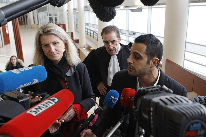 "Lawyers for the suspect Marc Goudarzian and Sandrine Parise-Heideiger, left, answer reporters at the hall of justice Tuesday, Feb.13, 2018 in Pontoise, outside Paris. A 29-year-old man is set to appear in a French court Tuesday for having sex with an 11-year-old girl last year, in a trial that has rekindled debate on the age of sexual consent in France. In a decision that shocked many, the prosecutor's office in the Paris suburb of Pontoise decided to send the man to trial on charges of ""sexual abuse of a minor under 15 years old,"" and not rape. (AP Photo/Francois Mori)"