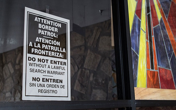 A sign warning U.S. authorities not to enter Shadow Rock United Church of Christ hangs by the sanctuary entrance.  The north Phoenix church has been a sanctuary for many immigrants seeking refuge.