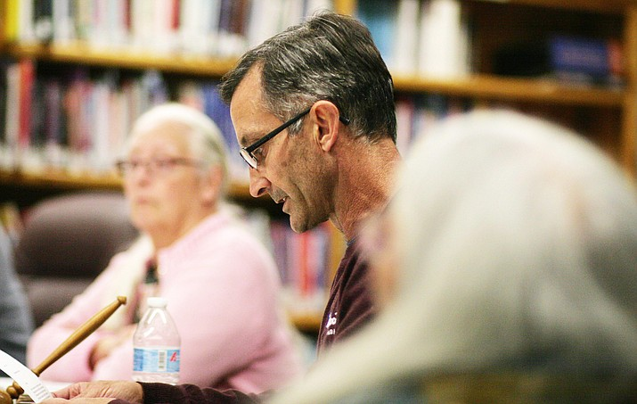 Camp Verde School Board President Tim Roth reads from a letter the board drafted to give Dr. Dennis Goodwin. The school board voted 4-to-1 to reassign to home Dr. Goodwin for the remainder of his contract, which expires on June 30. (Photo by Bill Helm)