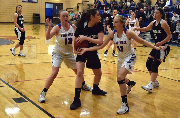 Camp Verde freshman Maya Hedges (12) goes for a steal against Paradise Honors during the regular season. The Cowboys open the state tournament as the sixth seed on Friday (VVN/James Kelley)