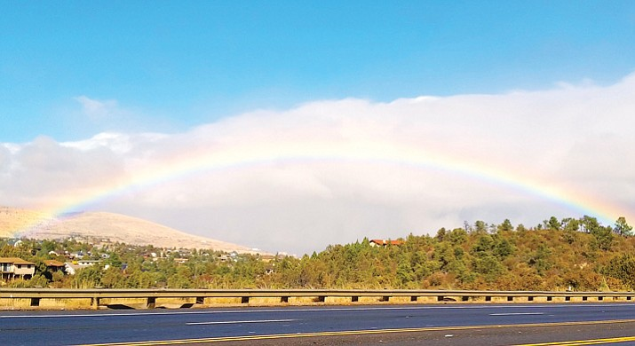 In the midst of an unusually dry, warm winter in Yavapai County, local resident Kathi Buss, from the vantage of Highway 69 near Costco, captured a photo of a rainbow over Prescott Valley after a storm moved through the area Monday. Rainwater harvesting can help homeowners make the most of scarce precipitation. (Kathi Buss/Courtesy)
