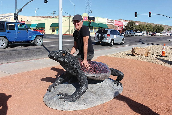Artist Solomon Bassoff of Faducci Studio in North San Juan, California, sits on his Arizona chuckwalla lizard sculpture that was unveiled Feb. 9. It's part of the City of Kingman's Art in Public Places program.