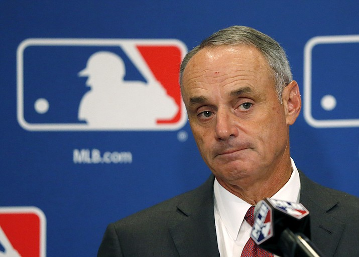 "In this Aug. 17, 2017, file photo, Commissioner Rob Manfred listens to a question following the two-day meeting of Major League Baseball owners in Chicago. Baseball Commissioner Rob Manfred says proposed rules changes to speed pace of play with be in place by the start of big league exhibition games on Feb. 23, 2018. Speaking Thursday, Feb. 15, 2018 at Tropicana Field, Manfred says ""one way or the other'' there will be rule changes. (Charles Rex Arbogast/AP, File)"