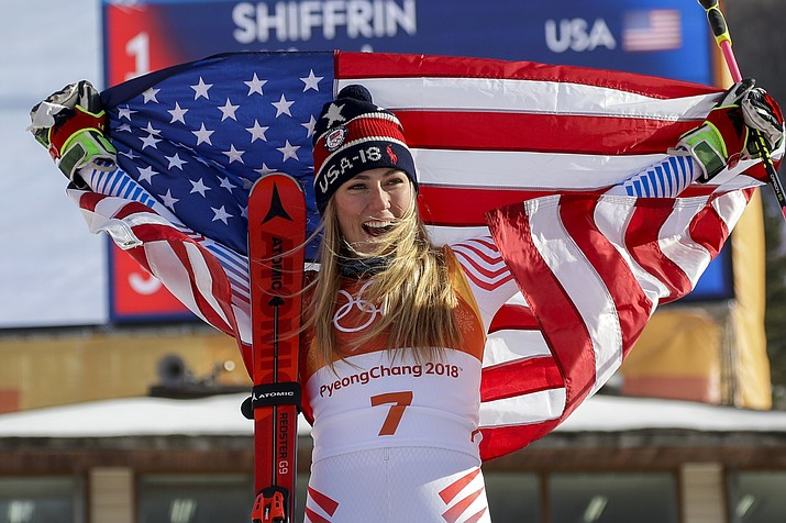 Mikaela Shiffrin, of the United States, celebrate her gold medal during the venue ceremony at the Women's Giant Slalom at the 2018 Winter Olympics in Pyeongchang, South Korea on Thursday, Feb. 15, 2018. (Morry Gash/AP)