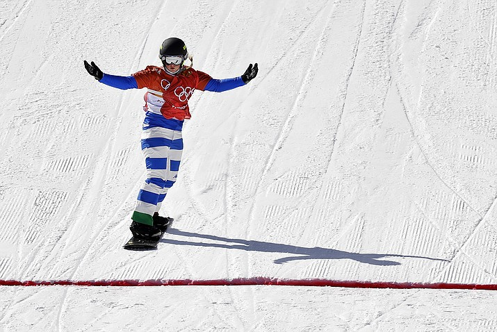 MichelaMoioli, of Italy, celebrates her win during the women's snowboard semifinals at Phoenix Snow Park at the 2018 Winter Olympics in Pyeongchang, South Korea on Friday, Feb. 16, 2018. (Kin Cheung/AP)