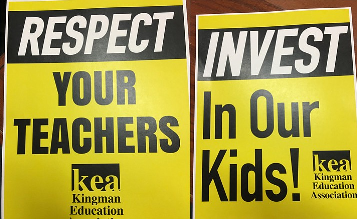 Members of the Kingman Education Association brought signs to communicate their message to the KUSD board Tuesday.