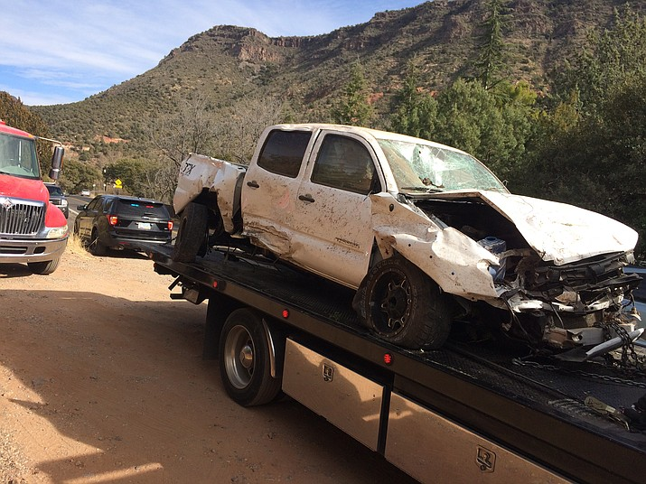 A white Toyota truck with Kansas license plates is removed from the scene of a deadly shooting Jan. 5, 2018, in Oak Creek Canyon. (Vyto Starinskas, Verde Independent)