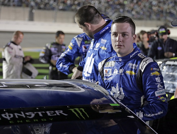 Alex Bowman climbs into his car before the first of two qualifying races for the NASCAR Daytona 500 auto race at Daytona International Speedway in Daytona Beach, Fla., on Thursday, Feb. 15, 2018. (Terry Renna/AP)